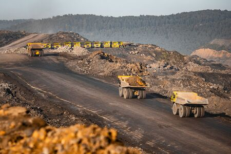 Foto de Big yellow mining truck for anthracite. Open pit mine, extractive industry for coal - Imagen libre de derechos