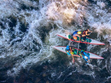Foto de Guy in kayak sails mountain river. Whitewater kayaking, extreme sport rafting. Aerial top view. - Imagen libre de derechos