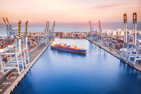 Photo for Large container ship leaves cargo port at sea, sunset. Aerial top view - Royalty Free Image