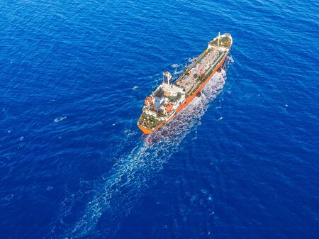 Photo for Oil chemical tanker sails blue sea. Aerial top view - Royalty Free Image