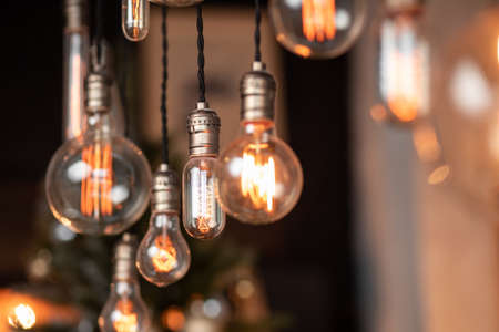 Photo for Edison lamp is included in loft room, against background of concrete wall - Royalty Free Image