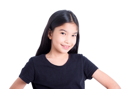 Photo pour Pretty asian girl standing and smiles over white background - image libre de droit