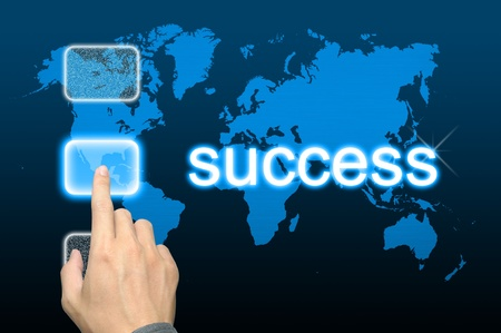 businessman hand pressing success button on a touch screen interface