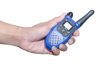 walkie-talkie radio in hand, isolated on white background