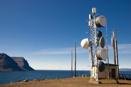Cell tower on Arnarnes in background Isafjardardjup - Iceland.