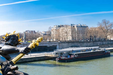 Photo for Paris, the Alexandre III bridge on the Seine, with houseboats on the river - Royalty Free Image
