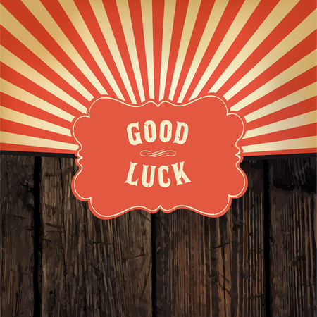 Wild west styled \Good Luck\ message on wooden board With red rays background