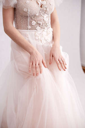 Photo for Girl in a wedding dress on a light background - Royalty Free Image