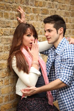 Photo pour young couple outdoors in inconvenient situation - image libre de droit