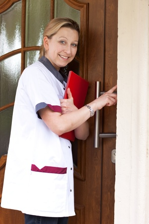 Geriatric nurse makes a house call and rings the door