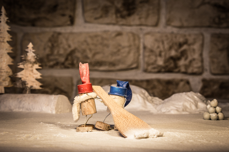 Concept two men and a snowpusher, wine cork figures