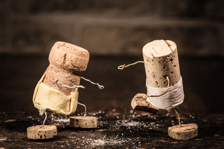 Concept Sumo wrestling with wine cork figures
