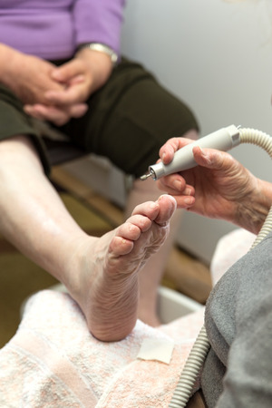 chiropody at a senior woman at home