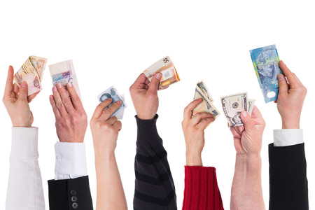 different currencies holding by different hands