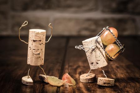 Concept Trouble between boss and employee, wine cork figures