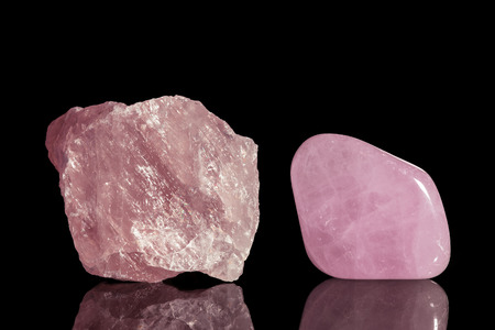 rose quartz, uncut and Tumble finishing with black background and reflection