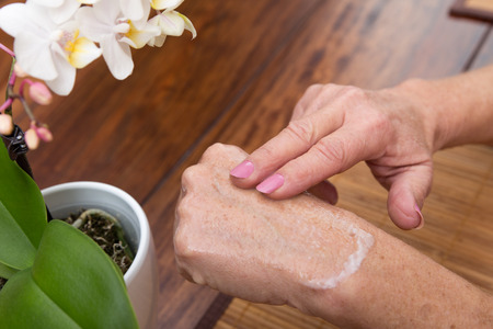 senior adults hands with lotion on it