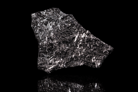 silicon stone, chemical element, black background, rough metallic