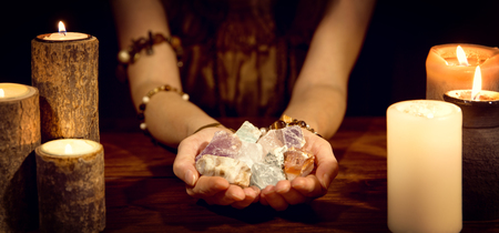 Photo for female fortune teller holding healing stones, concept esoteric and life coaching - Royalty Free Image