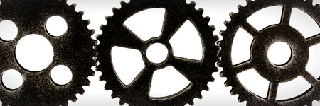 three gears in front of white background, concepts like teamwork or cooperation