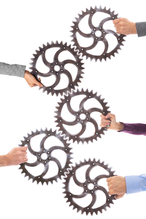 Photo pour Many different hands hold gears that mesh. Group dynamics and successful teamwork, business concept - image libre de droit