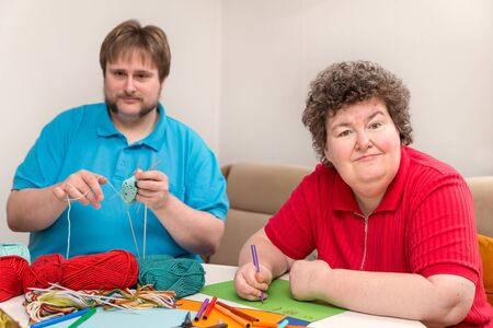 Photo pour a man and mentally disabled woman are tinker - image libre de droit