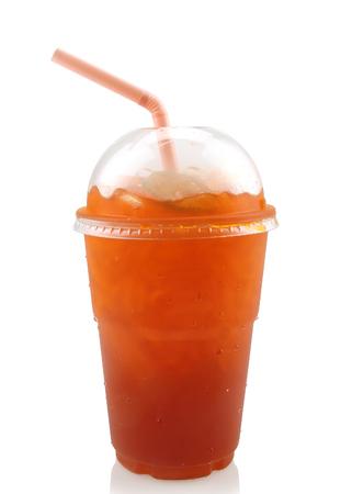 Foto de Lemon iced tea in plastic glass with straw isolated on white background. - Imagen libre de derechos