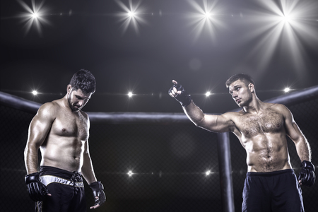 Photo for Two mma fighters in cage before fight - Royalty Free Image