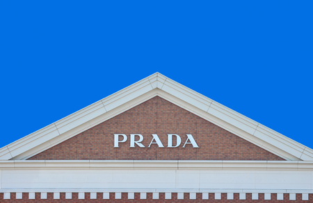 2019 March 26. Tochigi Japan. a modern design of PRADA brand name on gable roof brick wall with blue sky background at sano tochigi outlet mall.