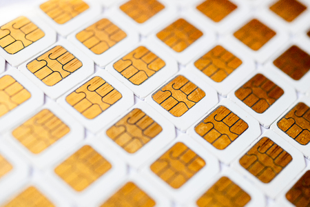 Photo pour Many Micro SIM 3G for mobile over on white background. - image libre de droit