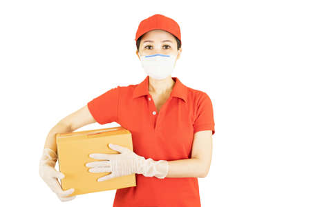 Photo for Asian staff holding a box isolated on white background. Courier in protective mask and medical gloves,concept delivers service under quarantine - Royalty Free Image