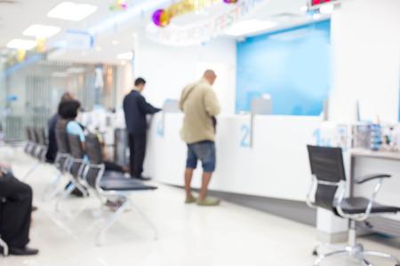 Foto de Blur image, people  in the bank - Imagen libre de derechos