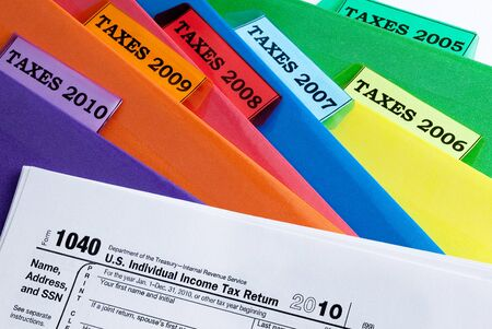 Colorful folders for income taxes of years 2010 - 2005