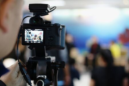 Photo for The media is recording video during the press conference. Journalists are interviewing, with the cameraman recording News agencies come together to make news. - Royalty Free Image