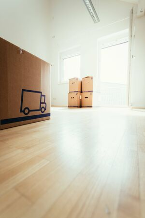 Photo pour Move. Cardboard, boxes and stuff for moving into a new home - image libre de droit