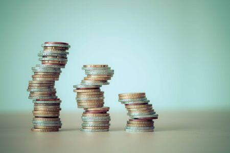 Foto de Coins stacked on each other, close up picture, market crisis and fragile market - Imagen libre de derechos