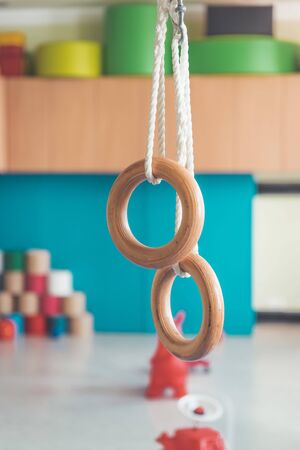 Close up of gym rings in the gym hall of a preschool