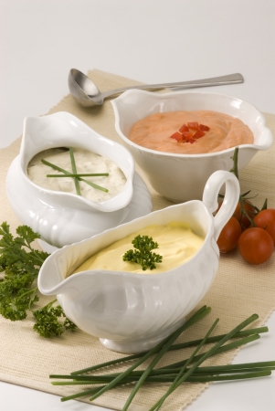 Mayonnaise cheese and cocktail sauces in sauceboats  Salad dressing