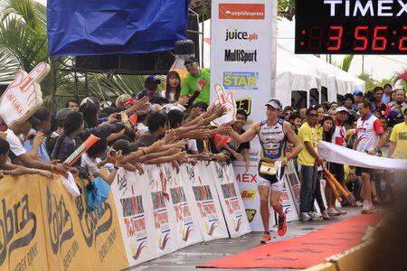 Photo pour CAMARINES SUR- Aug. 14: Pete Jacobs of Australia winning the Cobra Energy Drink Ironman 70.3 Philippines in Camarines Sur, Philippines on Sunday August 14, 2011. - image libre de droit