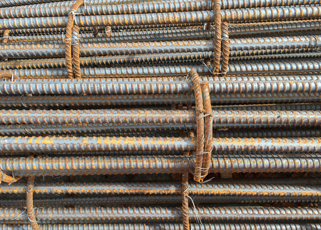 Photo pour Close-up photo of a rebar, reinforcing bar, reinforcing steel and reinforcement steel, a steel bar or mesh of steel wires used as a tension device in reinforced concrete and masonry structures. - image libre de droit