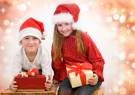 two sweet kids with christmas-presents