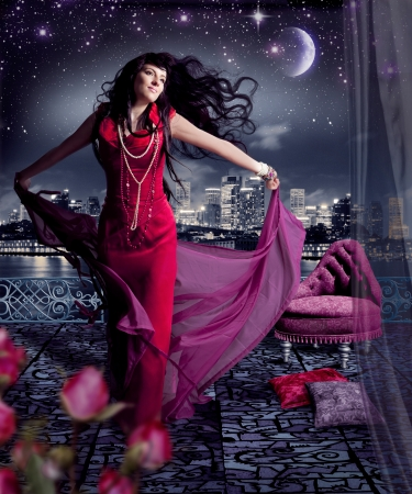 beautiful girl in evening dress on a terrace