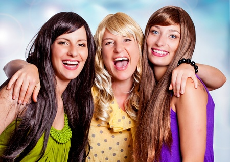 three girls with different haircolor laughing together