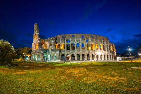 Foto de The Colosseum illuminated at night in Rome, Italy - Imagen libre de derechos