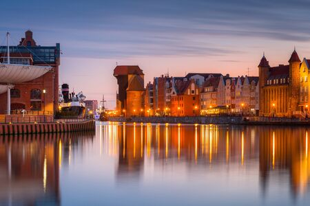 Photo for Gdansk with beautiful old town over Motlawa river at sunset, Poland. - Royalty Free Image
