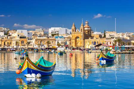 Photo for Traditional fishing boats in the Mediterranean Village of Marsaxlokk, Malta - Royalty Free Image