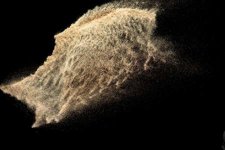 Photo pour Brown colored sand splash.Dry river sand explosion isolated on black background. - image libre de droit