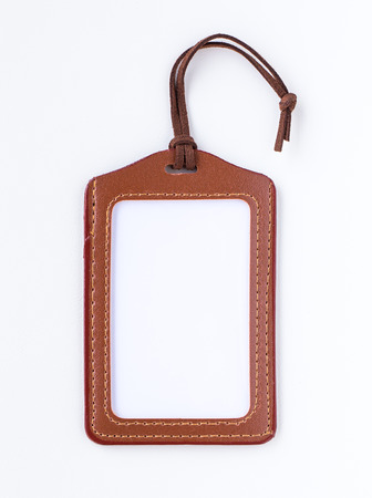 Brown leather label tag with string, isolated on the white