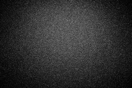 black sandpaper texture background.の写真素材