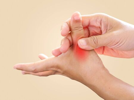 Hand pain and sore fingers, Thumb finger pain from work with nerve inflamed and trigger finger lock disease, Health care from illness concept.の素材 [FY310144694713]